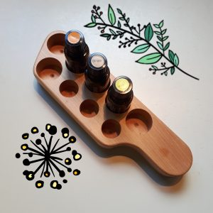 Wooden stand holding essential oils